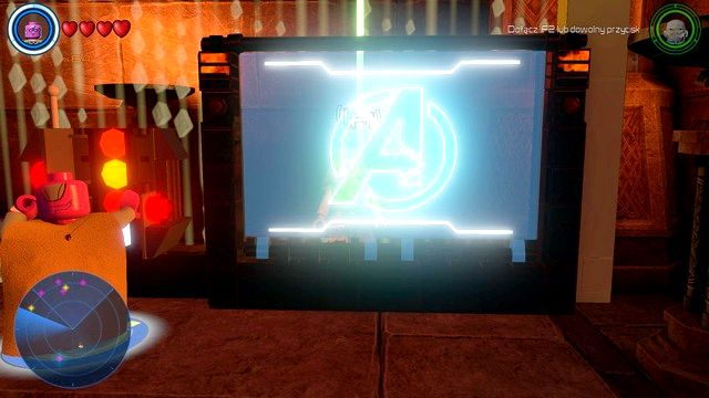 Once the console is powered, use it as Vision and use the parts displayed on the monitor to construct Avengers logo like the one shown on the above picture - Characters - Asgard - secrets - LEGO Marvels Avengers - Game Guide and Walkthrough